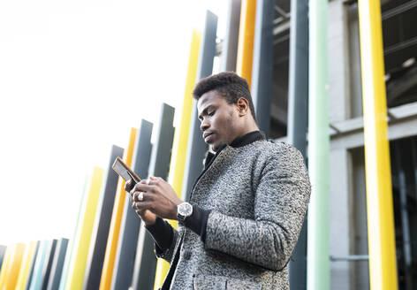 Portrait of elegant young man using phone - JCCMF00806