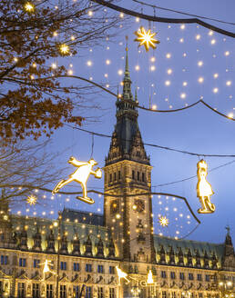 Germany, Hamburg, Town hall and Christmas decorations in city street - RJF00843