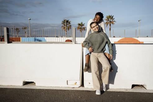 Spain, Valencian Community, Valencia. Portraits of happy women friends - RCPF00555