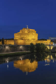 Italy, Rome, Castel Sant Angelo at night with reflection in Tiber river - ABOF00622
