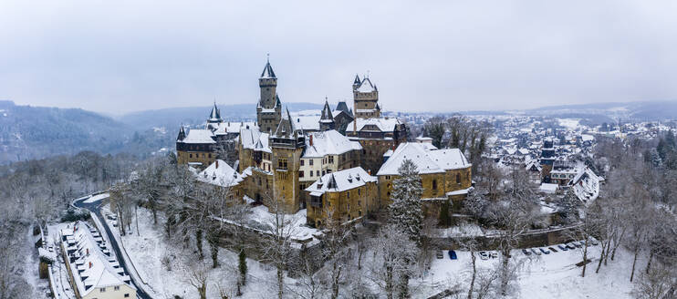 Germany, Hesse, Braunfels, Helicopter panorama of Braunfels Castle and surrounding town in winter - AMF09056