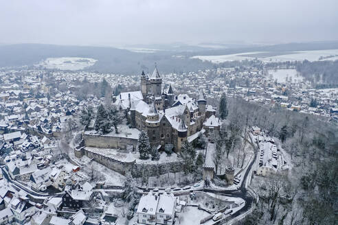 Germany, Hesse, Braunfels, Helicopter view of Braunfels Castle and surrounding town in winter - AMF09059