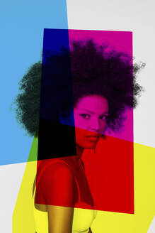 Confident woman with primary colors against white background - EIF00363