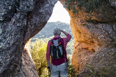 Backpacker admiring view while standing in natural park of Sant Llorenc del Munt i l'Obac at Catalonia, Spain - AFVF08159
