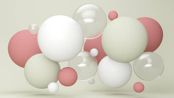 Three dimensional render of pastel colored bubbles floating against green background - JPSF00033