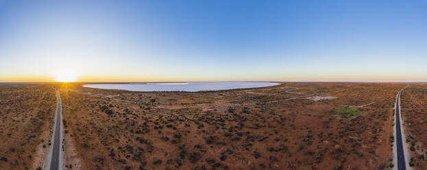 Australia, South Australia, Aerial view of Stuart Highway and salt lake in Lake Hart Area at sunset - FOF12115