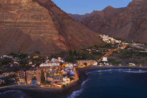 Spain, Valle Gran Rey, Drone view of town at edge of La Gomera island at dusk - SIEF10107