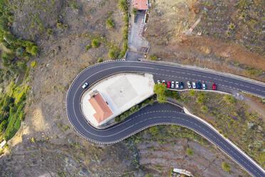 Spain, Valle Gran Rey, Drone view of highway winding around Kirche San Antonio - SIEF10110