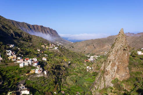 Spain, Hermigua, Drone view of Roques de San Pedro and small town in Garajonay National Park - SIEF10113