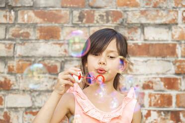 Child making soap bubbles - DRF01765