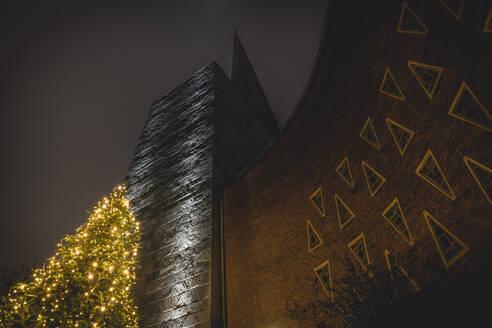 Germany, Hamburg, Saint Nikolai Church with Christmas treein Harvestehude at night  - KEBF01794