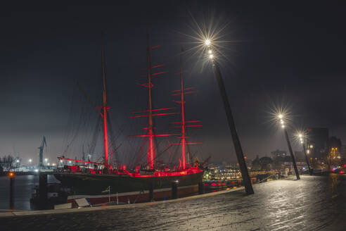 Germany, Hamburg, Museum ship illuminated at night - KEBF01800