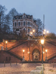 Germany, Hamburg, Kohlbrandtreppe staircase in Altona illuinated at dawn - KEBF01821