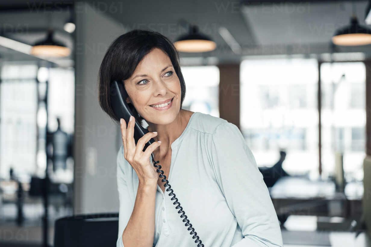 Female entrepreneur talking on telephone at office - JOSEF03717 - Joseffson/Westend61