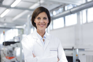 Smiling female scientist at laboratory - JOSEF03870