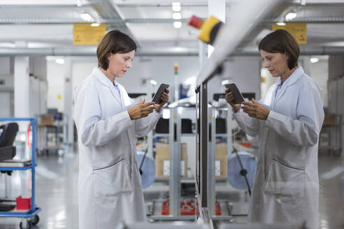 Female engineer using digital tablet at industry - JOSEF03873