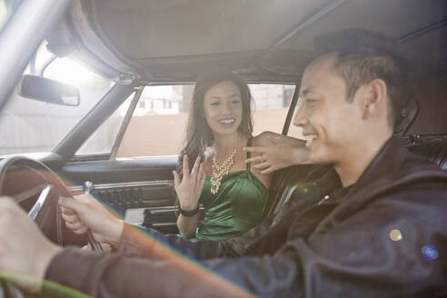 Boyfriend talking with girlfriend while driving car - AJOF01087